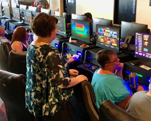 people gaming in Derby City with electronic pull tabs at Shirley's Charitable Gaming in Louisville, KY