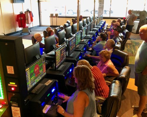 people gaming in Louisville with electronic pull tabs at Shirley's Charitable Gaming